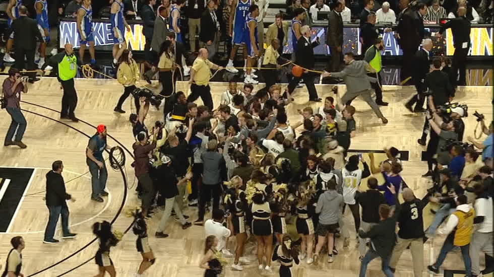 Wake Forest fans storm the court after upsetting No. 7 Duke ...